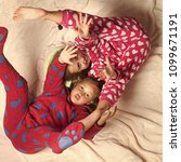 children in pajamas have fun in ... | Shutterstock . vector #1099671191