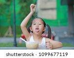 cheeky little asian kid girl... | Shutterstock . vector #1099677119