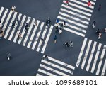 people walking crossing sign... | Shutterstock . vector #1099689101