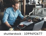 young entrepreneur working on... | Shutterstock . vector #1099692677