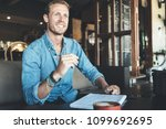 smiling entrepreneur working on ... | Shutterstock . vector #1099692695