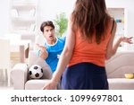 wife unhappy that husband is... | Shutterstock . vector #1099697801