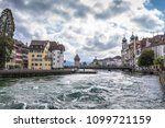 An old European city of Lucerne. Dam with waterfalls on a mountain lake. Switzerland