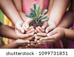 children and parent holding... | Shutterstock . vector #1099731851