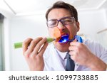 funny dentist with curing light ... | Shutterstock . vector #1099733885