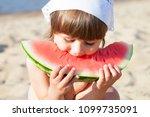 little girl eating watermelon... | Shutterstock . vector #1099735091