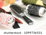 various combs on a table | Shutterstock . vector #1099736531