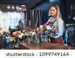 young florist with a bouquet of ... | Shutterstock . vector #1099749164