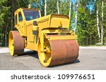 Big machine with its cylinder for smooth asphalt - stock photo