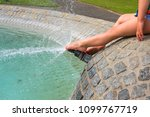 feet of a young child splashing ... | Shutterstock . vector #1099767719