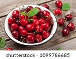 fresh summer berries. cherry in ... | Shutterstock . vector #1099786685