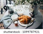 breakfast with croissants  jam... | Shutterstock . vector #1099787921