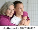 portrait of exited grandmother... | Shutterstock . vector #1099802807