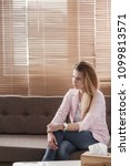 young woman with depression... | Shutterstock . vector #1099813571