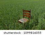 mahogany chair with a golden...   Shutterstock . vector #1099816055