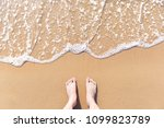 feet on sea sand and wave with... | Shutterstock . vector #1099823789