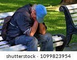 man sitting on the bench   Shutterstock . vector #1099823954