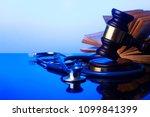 hand holding law gavel   Shutterstock . vector #1099841399