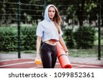 sporty woman holding in hands... | Shutterstock . vector #1099852361