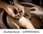 pottery training. the hands of...   Shutterstock . vector #1099854041