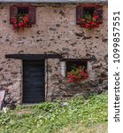 Small photo of Valpelline, Aosta Valley, Italy. Flowery windows in the village of Prarayer, on the lake of Place Moulin. In the background, Dent d'Hérens and Grandes Murailles.