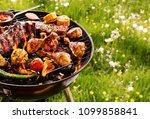 summer barbecue cooking over a... | Shutterstock . vector #1099858841