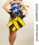 Small photo of Female slim fit body wearing colorful swimsuit with mask tuba, flippers and snorkel studio shot on grey. Girl preparing to summer vacation. Snorkeling gear, swimming concept.