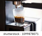 espresso coffee pouring from... | Shutterstock . vector #1099878071