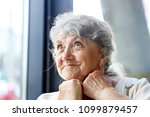 smile and looking elderly woman ...   Shutterstock . vector #1099879457