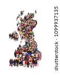 Small photo of Colored map of Great Britain from people. Crowd of people standing in shape of map of Great Britain. People making map of Great Britain