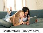 beautiful blonde cute little... | Shutterstock . vector #1099945391