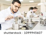 serious concentrated handsome... | Shutterstock . vector #1099945607