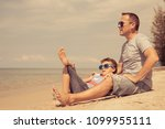 father and  son playing on the... | Shutterstock . vector #1099955111