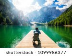 travel hiker taking photo of... | Shutterstock . vector #1099986377