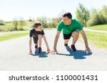 father with son sport running... | Shutterstock . vector #1100001431