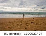 sunset in arenal de moris beach ... | Shutterstock . vector #1100021429