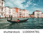 venetian gondolier punting... | Shutterstock . vector #1100044781