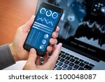 investor analyzing stock market ... | Shutterstock . vector #1100048087