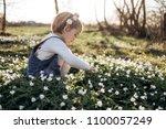 little girl collects flowers | Shutterstock . vector #1100057249
