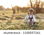 the small girl sitting near...   Shutterstock . vector #1100057261