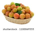 yellow plums in the basket | Shutterstock . vector #1100069555