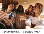 group of happy young women... | Shutterstock . vector #1100077964