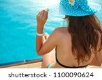 woman in a straw hat relaxing... | Shutterstock . vector #1100090624