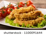 golden fried chicken strips in... | Shutterstock . vector #1100091644