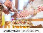 Thai culture wedding ceremony, parent will pour some water on groom and bride