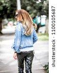 beautiful young woman wearing... | Shutterstock . vector #1100105687
