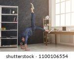 short break for yoga in office. ... | Shutterstock . vector #1100106554