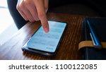 a man use smart phone show... | Shutterstock . vector #1100122085