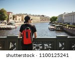 stylish male tourist with... | Shutterstock . vector #1100125241