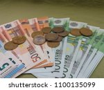 euro banknotes and coins money  ... | Shutterstock . vector #1100135099